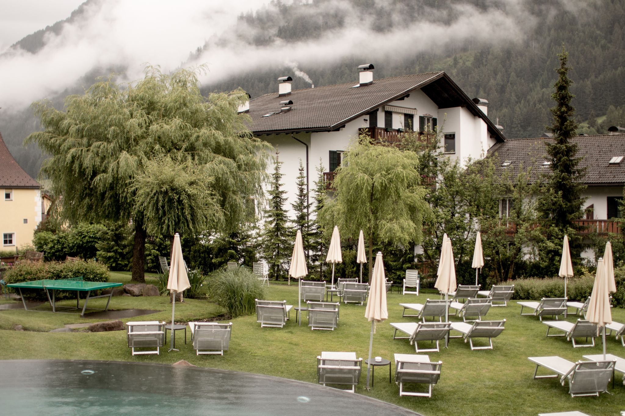 Adler Dolomites Hotel Ortisei Italy Hotel Review Exterior poolside clouds