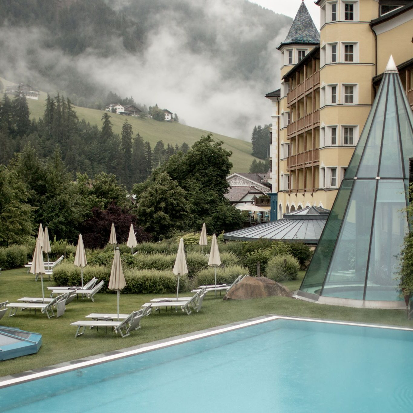 Adler Dolomites Hotel Ortisei Italy Hotel Review Exterior poolside clouds glass pyramid